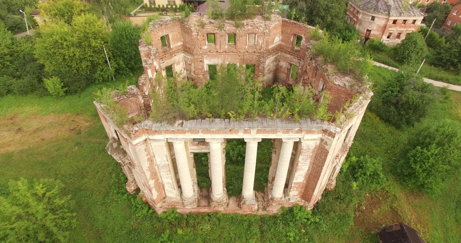 4K aerial summer morning drone video of abandoned dilapidated vintage beautiful mansion among green woods and grassy land built in 1700s totally destroyed nowadays | Shutterstock HD Video #1036000982