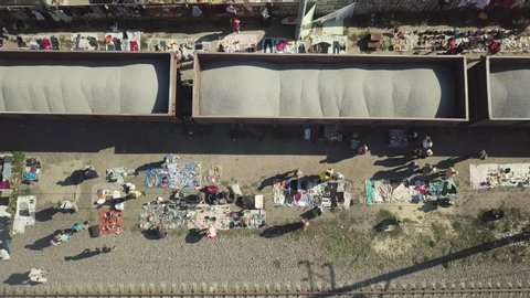 Kiev, Ukraine, August 2019: The spontaneous market for second-hand goods in the Podolsky district of Kiev in Ukraine. Aerial view. People sell things near the rail. Economic crisis increases poverty
