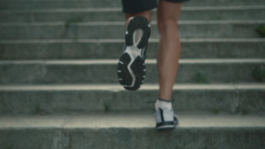 Runner Jogging Workout On Stairs.Sportsman Fitness Cardio Endurance Exercise.Running Workout Marathon Race.Jogger Athlete Legs Running Up Steps.Runner Training Triathlon Sport Recreation Competition Royalty-Free Stock Footage #1036027028