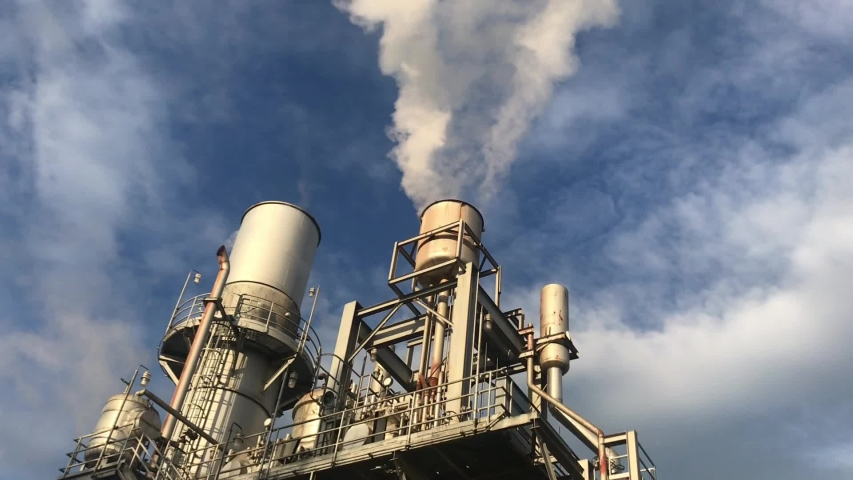 Power plant blow out steam from stack boiler. Boiler start up vent steam witch blue sky background.  | Shutterstock HD Video #1036039058