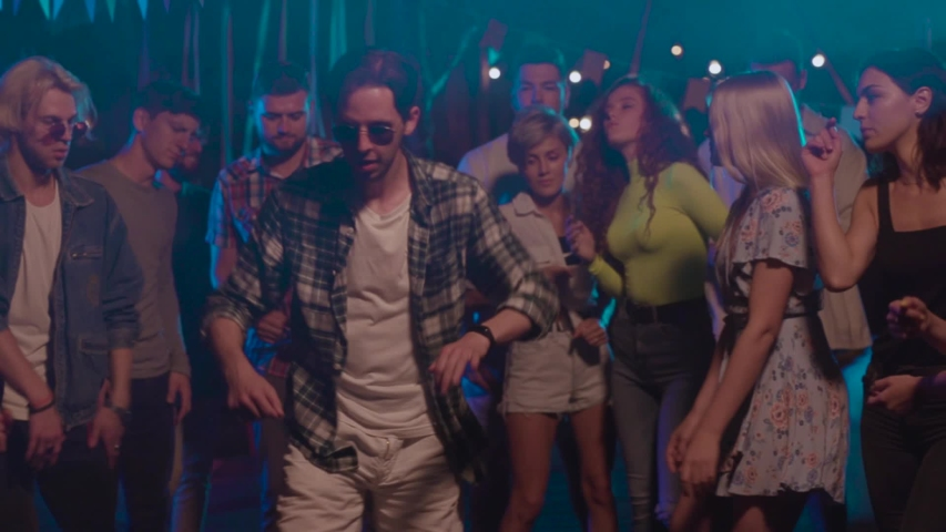 Young group of friends dancing together enjoying party music at night having fun celebrating weekend connection cheerful friendship gathering man nightlife entertainment hanging out slow motion | Shutterstock HD Video #1036041230