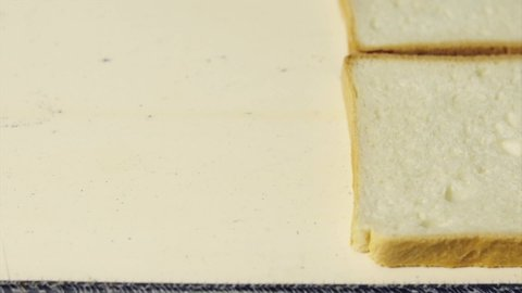 fabricated toast production, mass production of toast is made. Manufacture of triangle sandwich in factory.