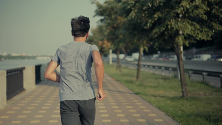 Athlete Jogging In City, Preparing Triathlon.Sport Healthy Lifestyle.Runner Prepares For Marathon Hard Training Before Running Competition.Sportsman Jog Cardio Workout.Running Man Exercising Outdoors. | Shutterstock HD Video #1036069439