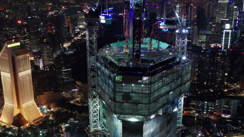 Kuala Lumpur Malaysia - 30 August 2019, aerial shoot around Permodalan Nasional Berhad tower at Kuala Lumpur, noise are existed in a drone footage video | Shutterstock HD Video #1036102916