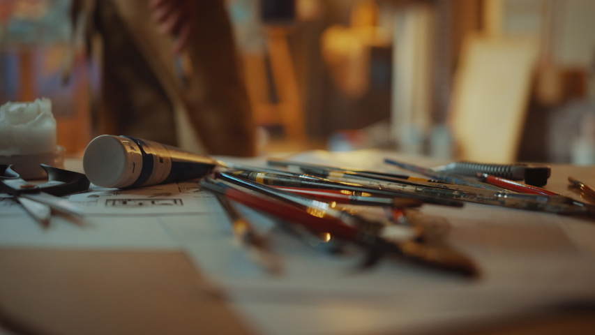 Unseen Artist Picks up Paint Brush and Returns to a Painting Colorful, Emotional, Sensual Oil Painting. Contemporary Painter Creating Abstract on a Canvas in the Modern Art in the Studio | Shutterstock HD Video #1036107749