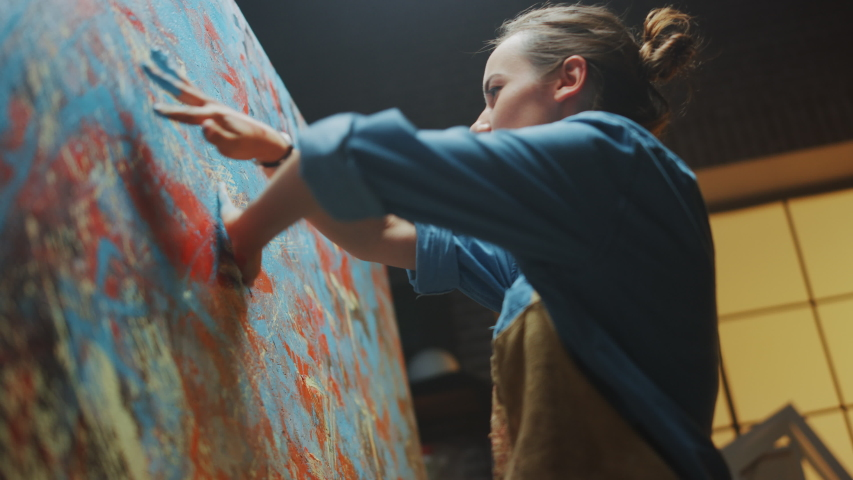 Talented Innovative Female Artist Draws with Her Hands on the Large Canvas, Using Fingers She Creates Colorful, Emotional, Sensual Oil Painting. Contemporary Painter Creating Abstract Modern Art Royalty-Free Stock Footage #1036107752