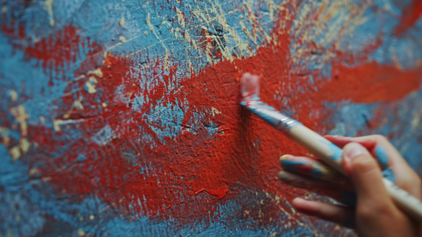 Close-up Shot of Female Artist Hand, Holding Paint Brush and Drawing Painting with Red Paint. Colorful, Emotional Oil Painting. Contemporary Painter Creating Modern Abstract Piece of Fine Art | Shutterstock HD Video #1036107764