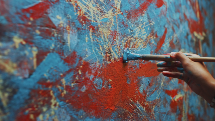 Close-up Shot of Female Artist Hand, Holding Paint Brush and Drawing Painting with Blue Paint. Colorful, Emotional Oil Painting. Contemporary Painter Creating Modern Abstract Piece of Fine Art   Shutterstock HD Video #1036107770