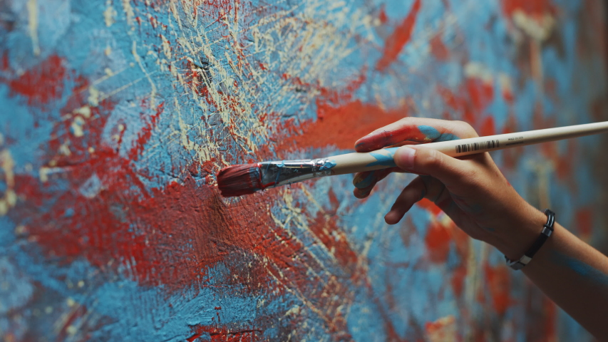 Close-up Shot of Female Artist Hand, Holding Paint Brush and Drawing Painting with Red Paint. Colorful, Emotional Oil Painting. Contemporary Painter Creating Modern Abstract Piece of Fine Art   Shutterstock HD Video #1036107785