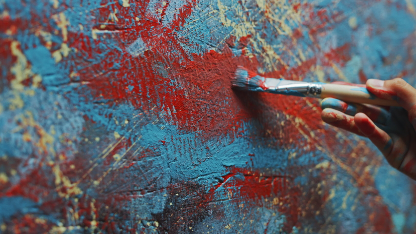 Close-up Shot of Female Artist Hand, Holding Paint Brush and Drawing Painting with Red Paint. Colorful, Emotional Oil Painting. Contemporary Painter Creating Modern Abstract Piece of Fine Art   Shutterstock HD Video #1036107788