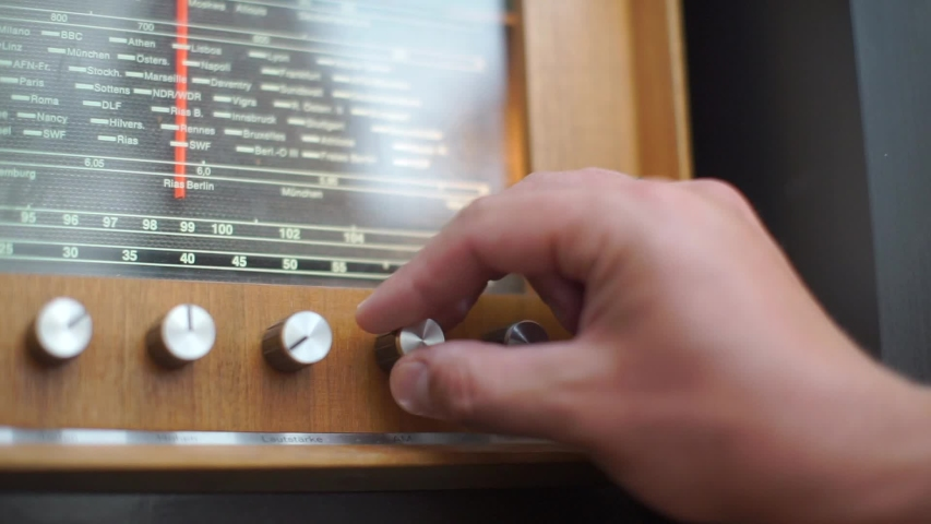 Close-up of using an old tube radio, a collection of old radios | Shutterstock HD Video #1036108280