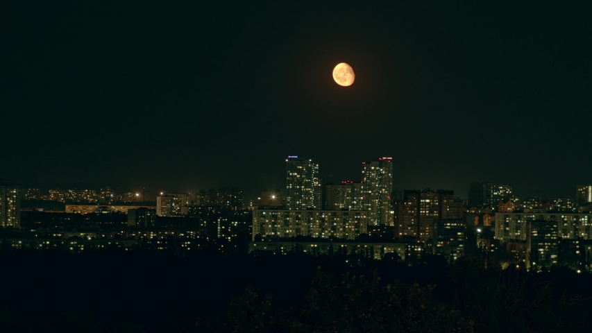 Moon over the night city   Shutterstock HD Video #1036109204