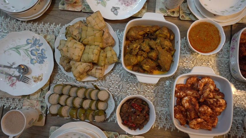 Malaysian local traditional food, lemang, ketupat, ketupat palas and other eat during eid mubarak or known as Hari Raya Aidilfitri celebration. Eat together with curry or rendang. Royalty-Free Stock Footage #1036111535