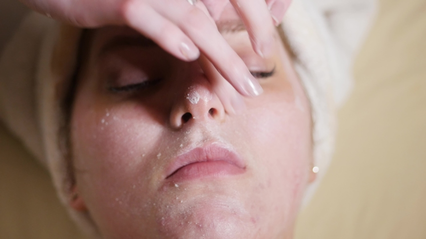 HEBER, UT, UNITED STATES, JULY 9, 2019: young woman receiving a facial close up on her face as she receives a facial. Close up on client's face as esthetician works on her during facial at a spa. | Shutterstock HD Video #1036148927