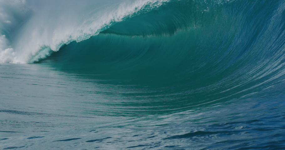 SUPER SLOW MOTION: Giant glassy blue ocean wave breaking and barreling with spray