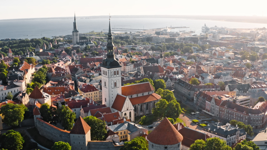 Tallinn, Estonia: morning drone view of Walls of Tallinn and St. Nicholas' Church in old town | Shutterstock HD Video #1036157276