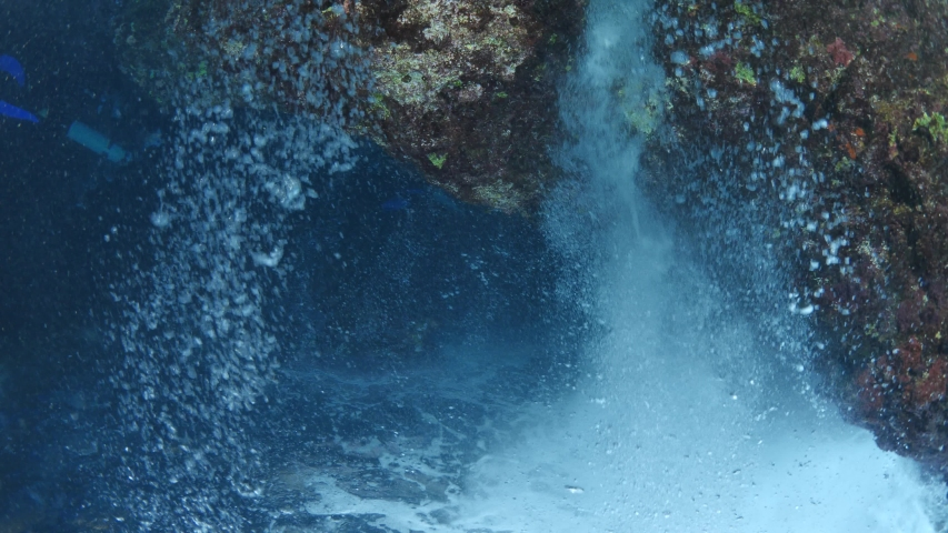 Upside down filming of underwater with rocks bubbles waves and sun rays and beams underwater abstract scenery unusual   Shutterstock HD Video #1036158566