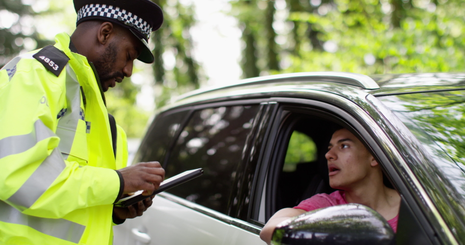 4K Policeman asking young driver to get out of his car & get into police vehicle Royalty-Free Stock Footage #1036163228