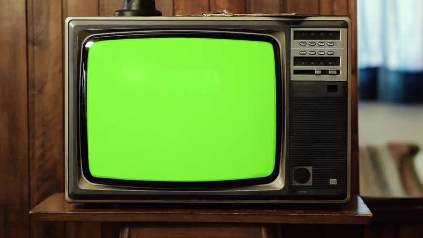 "Vintage Television Set Green Background with Noise and Static. Zoom Out. You can replace green screen with the footage or picture you want with ""Keying"" effect in AE (check tutorials in YouTube). 
