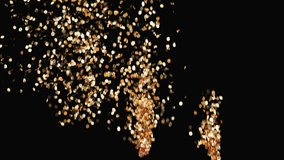 Golden confetti party popper explosions and falling down on the black background