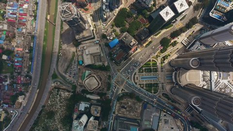 KUALA LUMPUR, MALAYSIA - OCTOBER 11 2018: downtown sunny day famous towers traffic square aerial topdown panorama 4k circa october 11 2018 kuala lumpur, malaysia.