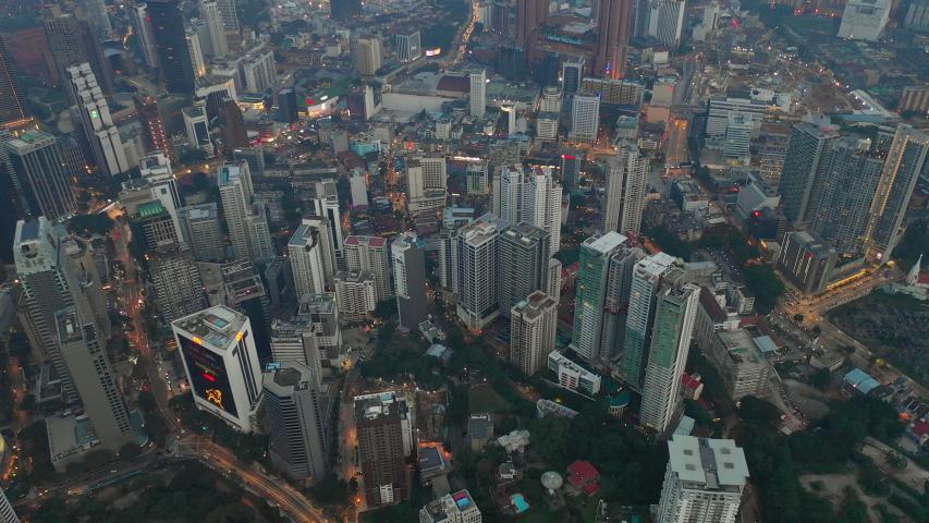 KUALA LUMPUR, MALAYSIA - OCTOBER 11 2018: sunset night illumination kuala lumpur cityscape streets aerial topdown panorama 4k circa october 11 2018 kuala lumpur, malaysia. | Shutterstock HD Video #1036205816