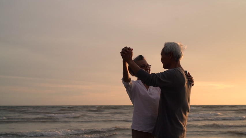 Asian couple senior elder retire resting relax dancing at sunset beach honeymoon family together happiness people lifestyle, Slow motion footage | Shutterstock HD Video #1036213991