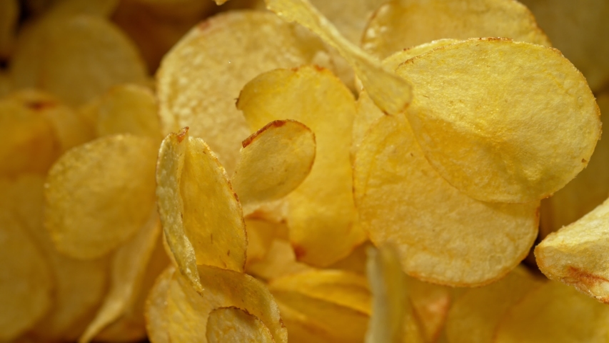 Super Slow Motion Shot of Potato Chips Flies After Being Exploded against Black Background, 1000fps. | Shutterstock HD Video #1036230935