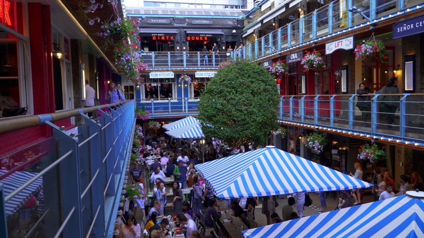 LONDON, UK- AUGUST 29, 2019. Carnaby Street Bar and restraurant dinning, people enjoying eating and drinking outdoor, Kingly Court | Shutterstock HD Video #1036233434