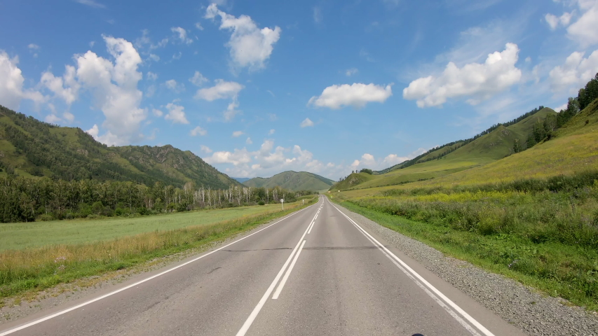 Travel by car. car ride on a mountain winding road on a summer day. POV driving. Car quickly rides along asphalt road in countryside in summer day outdoor along mountains. first person view. 4K | Shutterstock HD Video #1036237487