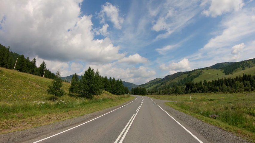 Beautiful nature POV vehicle drive, hilly scenery car travel, mediterranean coast curvy asphalt road point of view, blue sky with clouds horizon. POV driving. video footage stock. 4K | Shutterstock HD Video #1036237832