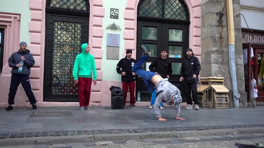 LVIV, UKRAINE - AUGUST 28, 2019: Unknown guys dance break on the street of the city. | Shutterstock HD Video #1036238618