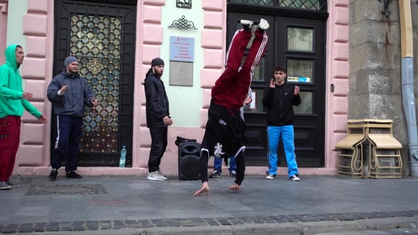 LVIV, UKRAINE - AUGUST 28, 2019: Unknown guys dance break on the street of the city. | Shutterstock HD Video #1036238624