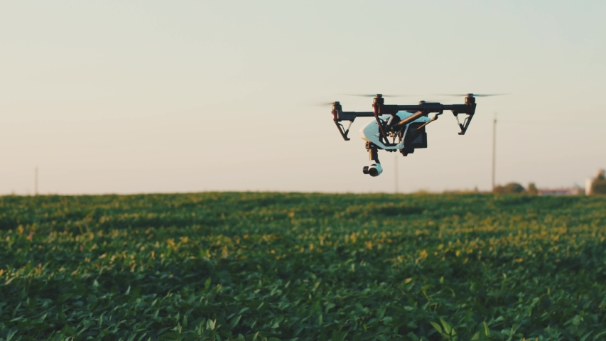 Flying smart agriculture drone in sky rural aerial helicopter agros copter farm farming field industry landscape meadow nature plant professional vehicle aircraft harvest innovation slow motion Royalty-Free Stock Footage #1036241081