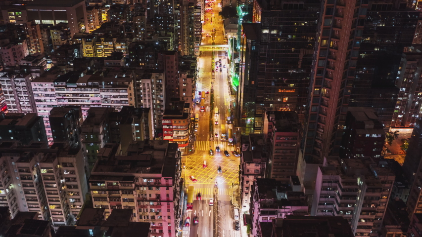 4K UHD Hyperlapse time-lapse of car traffic on road and people walking at night in Hong Kong downtown district, drone aerial dolly top view. Commuter, Asia city life, or public transportation concept | Shutterstock HD Video #1036251926