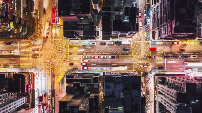 4K UHD Time-lapse of car traffic on road and people crossing street at night in Hong Kong downtown district, drone aerial top view. Commuter, Asia city life, or public transportation concept   Shutterstock HD Video #1036252004