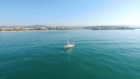 Sailing boat with a mediterranean village