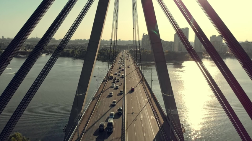 Flight of the camera through the cable-stayed bridge in Kiev | Shutterstock HD Video #1036258634
