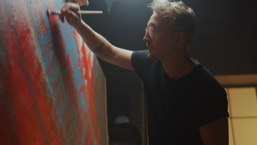 Portrait of Talented Artist Working on Abstract Painting, Uses Paint Brush To Create Daringly Emotional Modern Picture. Dark Creative Studio Large Canvas Stands on Easel. Side View Closeup Arc Shot   Shutterstock HD Video #1036270022