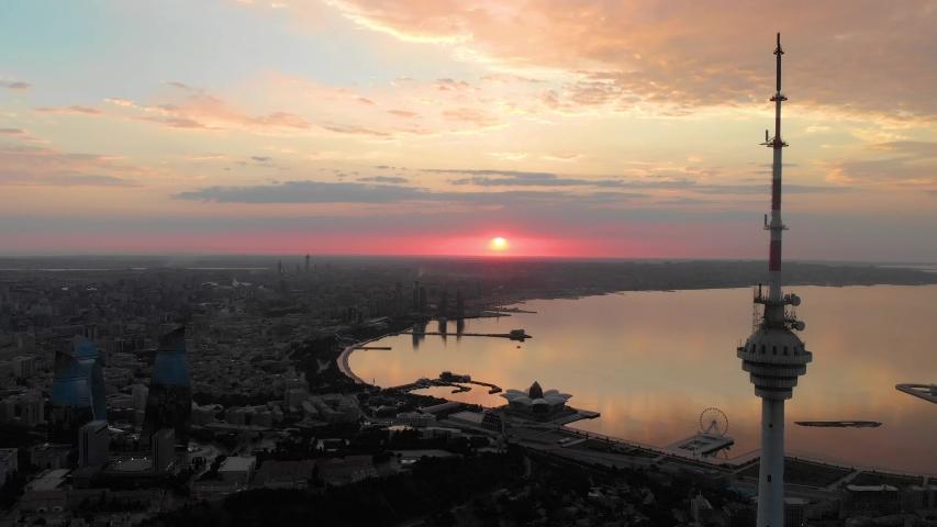 Baku, Azerbaijan - June 2019: Baku TV Tower at sunrise. Aerial view. Highest structure in Azerbaijan, 310 meters