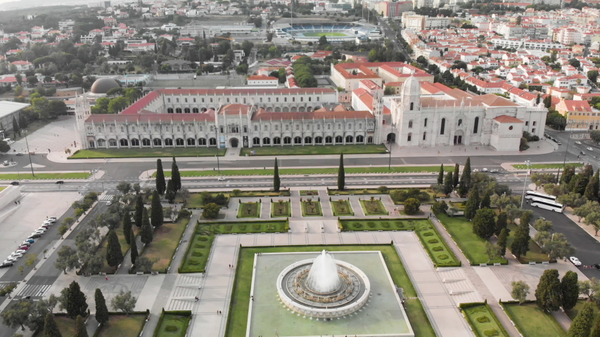 Empire Square and the Jeronimos Monastery in Lisbon Portugal with cityscape in background. Drone shot.
