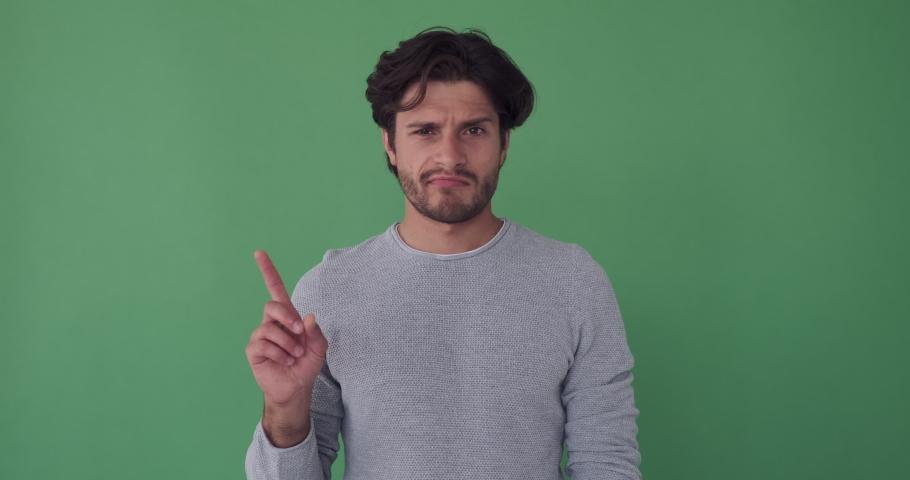 Man saying no by waving his finger over green screen | Shutterstock HD Video #1036283282