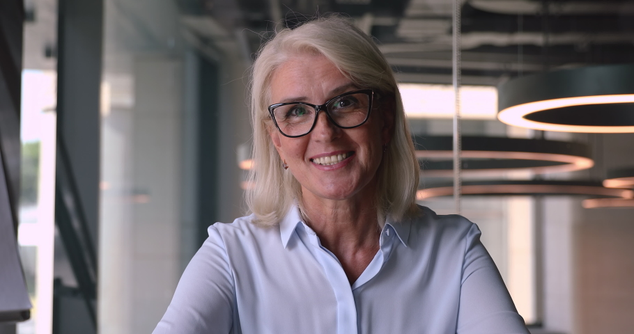 Happy middle aged mature businesswoman executive teacher looking at camera talking, smiling older senior business coach recording training webinar teach online make video conference call, webcam view Royalty-Free Stock Footage #1036284635