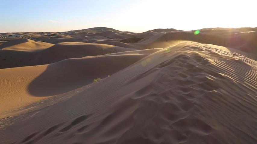 Sand storms in desert in windy day in XiangshaWan, or Singing sand Bay, in hobq or kubuqi desert, Inner Mongolia, China