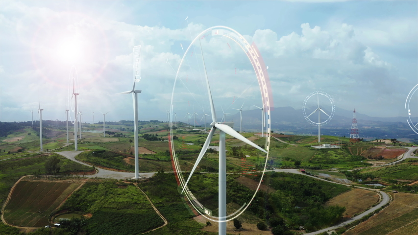 Aerial view of windmills with digitally generated holographic display tech data visualization. Wind power turbines generating clean renewable energy for sustainable development in a green ecologic way Royalty-Free Stock Footage #1036297358