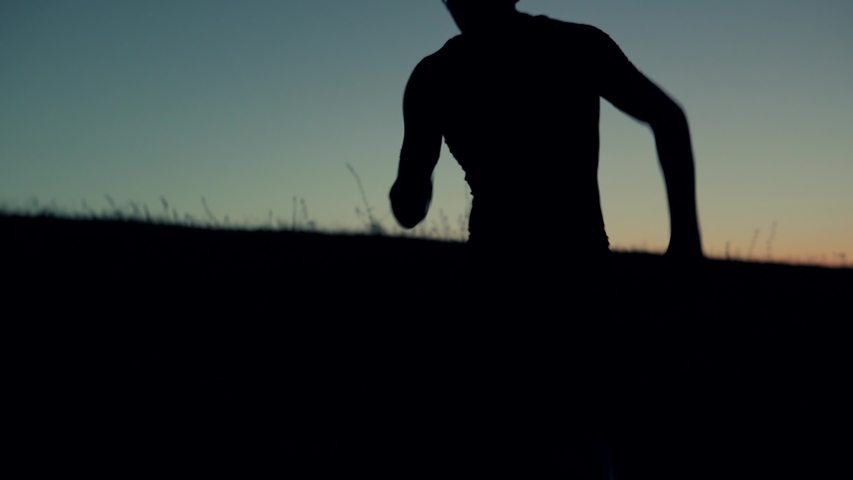Running Silhouette Training Outdoors For Marathon Or Triathlon At Sunrise.Triathlete Sport Recreation Run Workout On Sunset.Runner Silhouette Jogging At Dusk On Trail.Running Endurance Trail Workout Royalty-Free Stock Footage #1036307726