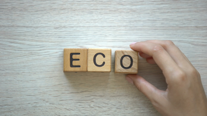 Eco, woman making word of cubes, goods and services with no harm to ecosystems | Shutterstock HD Video #1036308545