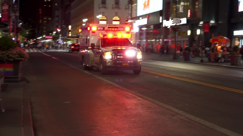 NEW YORK CITY, USA -  22nd of June 2019: An ambulance with siren in New York City at night. Sound included.