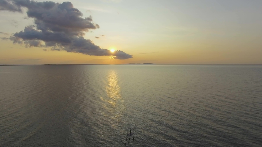 AERIAL : Rippled water surface of sea on sunset. Golden reflections on sea water surface at sunrise, aerial video, drone point of view, drone flying above the sea surface, close up | Shutterstock HD Video #1036327379
