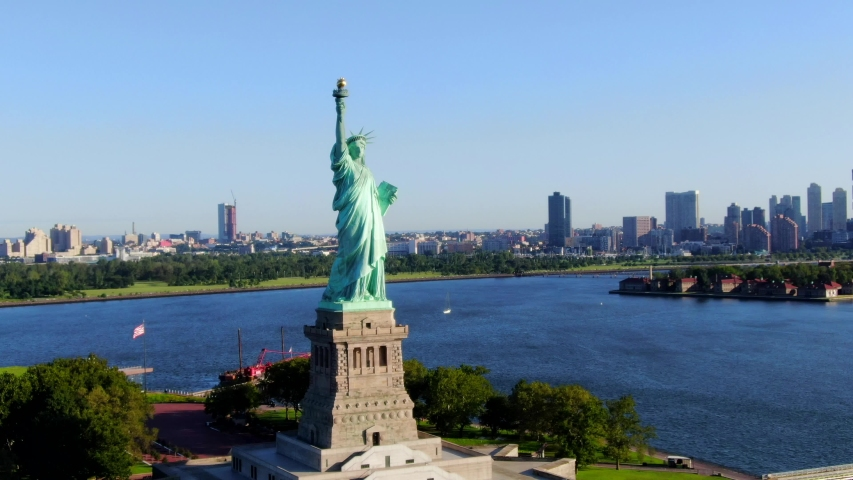 This video shows aerial views of the Statue of Liberty.  The Statue of Liberty is a colossal neoclassical sculpture on Liberty Island in New York Harbor in New York, in the United States. | Shutterstock HD Video #1036327682